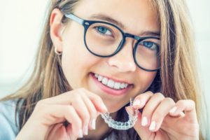 Woman with Invisalign in Collierville